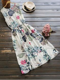 AD : Sleeveless Drawstring Floral Midi Dress - FLORAL   Style: Casual   Occasions: Beach and Summer   Material: Linen   Silhouette: A-Line   Collar-line: Round Collar   Dresses Length: Mid-Calf   Sleeves Length: Sleeveless   Pattern Type: Floral   With Belt: No   Season: Fall,Spring,Summer   Weight: 0.2700kg   Package: 1 x Dress