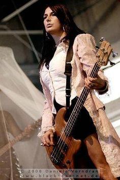Playing a Wal bass.