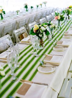 Table runner inspiration - white linens and dishes with a splash of color down the center.
