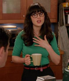Zooey Deschanel's Green 3/4 sleeve top with a black skirt and red skinny belt on New Girl.  Outfit Details: http://wwzdw.com/z/2285/ #WWZDW