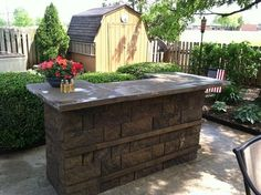 Cinder Block Outdoor Table with grill and bar | Outdoor Kitchens and BBQ Surrounds