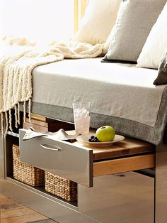 Find unexpected yet convenient storage space under your mattress. Join kitchen cabinet components to fashion a platform bed base. Fill open shelves with baskets of reading material and deep drawers with folded clothing. Top a shallow drawer with a slab of wood or countertop to serve as a pull-out nightstand.