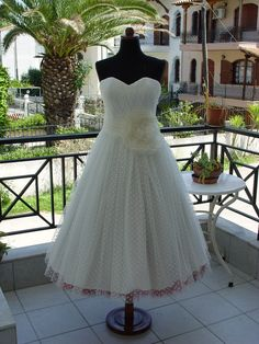 Polka Dot Tea Length Wedding Dress With Colourful Petticoat by atelierTAMI on Etsy https://www.etsy.com/listing/102401899/polka-dot-tea-length-wedding-dress-with