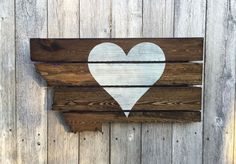 This jigsawed Montana is handmade out of upcycled pallets. Large heart across…
