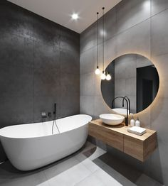 Large bathroom tiles evoke a sense of calmness and spaciousness, and work perfectly in bathrooms with limited space. It is also a good idea to tile the floor and ceiling with the same tile in order to create a sense of continuity, which ultimately makes the room feel larger. Read our blog for more style and space-saving tips! #bathroomtiles #smallbathrooms #bathroomdesignideas #bathroomstyletips #bathroomdesigntips #bathroomdesign #bathroomremodel #bathrooms