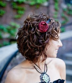 curly bob with a hair flower