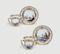 A pair of Meissen two-handled beakers and saucers, circa 1730, blue crossed swords marks, gilder's 39. to each piece, both saucers with Dreher's ++ to footrim