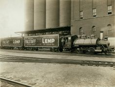 Western Cable Railway Company Engine No. 4 hauling Falstaff beer in refrigerated railroad cars past the Lemp Brewery facility in St. Louis. (1912) The brewery operated its own rail line, which connected all of the plant's main buildings with the shipping yards near the river and major railroads. ©Missouri History Museum