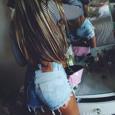 Sophie Harrison wearing our half and half shorts. Get yours at WILDESTDENIMDREAMS.COM