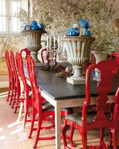 red dining chairs by elva. I love them.