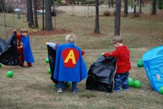 """This was the Kryptonite Catch game... we told the boys that Superman needs to be saved from Kryptonite...and the green balloons were suppose to represent Kryptonite...they had to fill their """"lead bags"""" with Kryptonite in order to save Superman."""