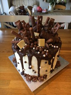 Chocolate explosion drip cake with milk and dark chocolate ganache