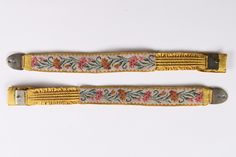 A rare pair of yellow silk and tapestry garters, early 19th century. woven with carnation repeats, with elasticated sections, silvered metal buckle and clasp, 30cm, 12in long (2). - See more at: http://kerrytaylorauctions.com/one-item/?id=42&sub=%20&auctionid=429#sthash.oPHTnpkJ.dpuf