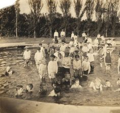 Children in a wading pool at Avondale Park in Birmingham, Alabama. :: Alabama Photographs and Pictures Collection