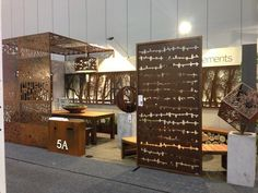 laser cut Autumn Cube metal sculpture, laser cut steel panel pergolas by Entanglements. Privacy screens and The Murray wall art for focal points