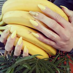 gel mandel nails .banana yellow color nails with glitter