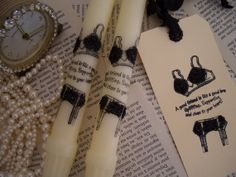 Pair of cream taper candles and matching tag. A good friend is like a good bra, uplifting, supportive, and close to your heart.