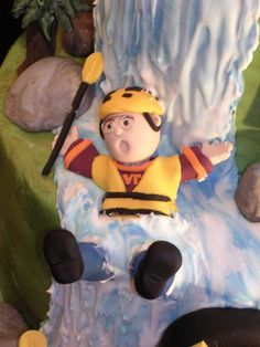 Gauley River rafting cake - this was done in fondant, he is a VA tech grad so I put him in a VTech shirt for a special touch.