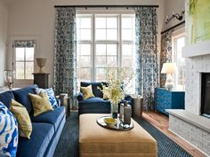 Varying heights and styles of window treatments in the same room looks cohesive if you use the same fabric at each window.