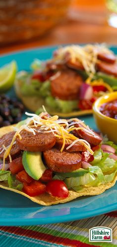 Change up taco night this week with a little help from Hillshire Farm® Smoked Sausage! These Smoked Sausage Fiesta Tostadas are sure to please the whole family using ingredients you already have! Find this recipe and more dinner delights here.