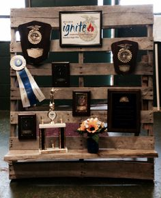 FFA Award Banquet- Chapter Awards display for welcome table. [Bandys FFA in North Carolina] Used a pallet and used brackets to attach a shelf for trophies. Supported in back with braces.
