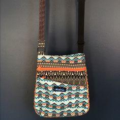Kavu cross body Adorable mixed pattern Kavu bag. Pockets galore and adjustable length strap. Kavu Bags Crossbody Bags