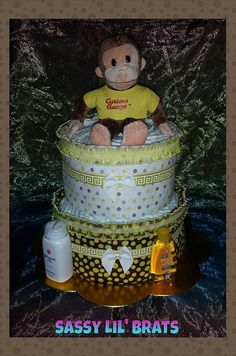 Check out this item in my Etsy shop https://www.etsy.com/listing/117919455/2-tier-curious-george-diaper-cake