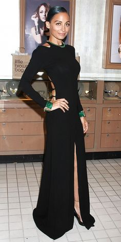 Nicole Richie accessorizes a long sleeve black dress with pops of rich green. // #Celebrity