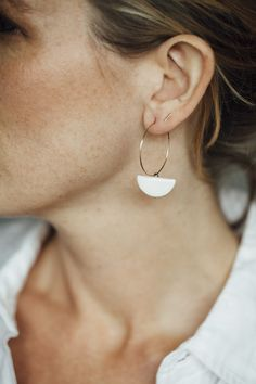 Ceramic and gold earrings by Jessica Wertz.