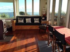 Treehouse in Lower Hutt, New Zealand. The tree house is a modern open plan studio built  2 years ago on a stunning 2,000 square metre very private tree covered section which runs down to the beach. The property enjoys all day sun and views over Wellington harbour.  The tree house is a...
