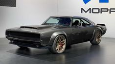 "Chrysler's Mopar brand has unveiled a retro muscle car concept at this year's SEMA show in Las Vegas. The 1968 Dodge ""Super Charger"" Concept has been created to not only showcase the brand's new supercharged Hemi ""Hellephant"" engine but also to mark […] 1968 Dodge Charger, Dodge Charger Models, Mopar, Triumph Motorcycles, Toyota Corolla, Us Cars, Sport Cars, Muscle Cars Dodge, Chevy"