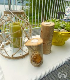 Dressing the deck for summer with DIY Upcycled Colander turned succulent planter, tree stump candle sticks, upcycled thrifted tray, and DIY Envelope Pillow Covers at thehappyhousie