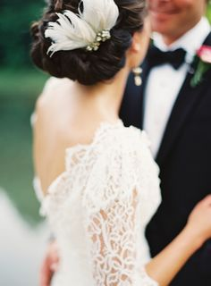 Chic chignon adorned with a feather headpiece