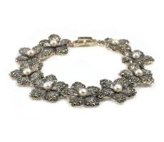 Intricate pearl and marcasite bracelet. Delicate flower petal links set with marcasites. http://www.vonscharfenberg.com/product/pearl-and-marcasite-flower-bracelet/