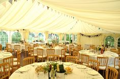 Wedding marquee with tables and homemade bunting.  Photo by Mark Sanderson.