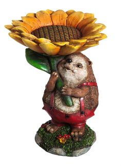 New Creative Sunflower Hedgehog Birdfeeder Garden Statue. This little garden hedgehog will keep your feathered friends company, and fed!. Sculpted from polystone resin. Painted and carved details bring this statue and bird feeder to life. Suitable for continued indoor or outdoor use; holds approximately 2 cup of birdseed. Measures approximately 7.25 x 9 x 7.25 inches.