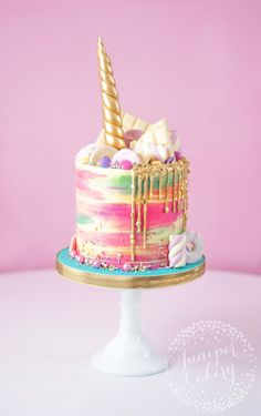 Rainbow buttercream unicorn cake by Juniper Cakery Unicorns are everywhere right now and they sure are perfect for parties. Team rainbows, unicorns and cake together and you get this amazing unicorn cake! Pretty Cakes, Cute Cakes, Beautiful Cakes, Amazing Cakes, Bolo Tumblr, Nake Cake, Cupcake Cakes, Food Cakes, Bolo Cake