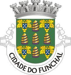 """Civic heraldry of Portugal - Brasões dos municípios Portugueses - Escudo de verde, com cinco pães de açúcar de ouro realçados em espiral e com base em púrpura, postos em cruz, acantonados, por quatro cachos de uvas de ouro sustidos e folhados do mesmo metal, cada cacho carregado por uma quina de azul carregada de cinco besantes de prata, em aspa. Coroa mural de prata de cinco torres. Listel branco, com a legenda a negro : """" CIDADE DO FUNCHAL """".   officially granted on March 24, 1936"""