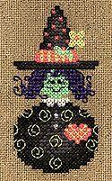 Little Miss Witch, Pam Kellogg cross stitch design using Kreinik glow in the dark threads