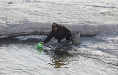 A  woman collects water from the icy Yalu River in the city of Hyesan on April 5, 2009. (REUTERS/Reinhard Krause (CHINA SOCIETY MILITARY POLITICS) # - See more at: http://www.boston.com/bigpicture/2009/04/peering_into_north_korea.html#photo18