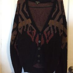 Boho cardigan Black cardigan with tribal print in hints of brown, yellow, and auburn with detailed buttons. Never worn. Didn't fit. Very warm. No damages. If any questions feel free to ask! Sweaters Cardigans