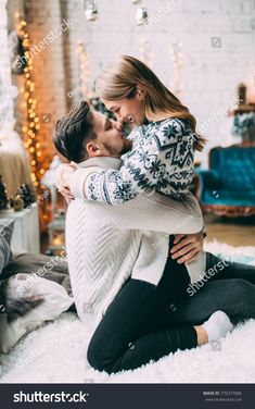 A guy with a girl is celebrating Christmas. A loving couple enjoys each other on New Year's Eve in a cozy home environment. New Year's love story. story new year Стоковая фотография «Guy Girl Celebrating Christmas Loving Couple Cute Couples Goals, Couples In Love, Romantic Couples, Couple Posing, Couple Shoot, Couple Ideas, Couple Photography, Photography Poses, Christmas Photography Couples