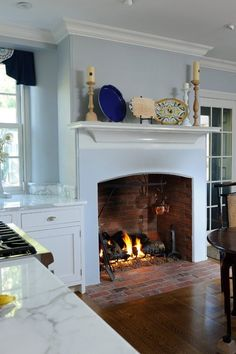 A farmhouse in Philadelphia features a cozy kitchen with a large fireplace measuring wide, deep and tall. (via Archer & Buchanan Architecture). 25 Fabulous kitchens showcasing warm and cozy fireplaces Farmhouse Fireplace, Cozy Fireplace, Fireplace Design, Kitchen Fireplaces, Fireplace Ideas, Country Fireplace, Cottage Fireplace, Fireplace Seating, Fireplace Cover