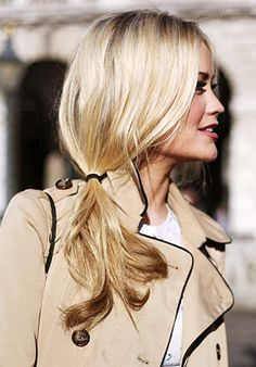 Gather loose curls into a low side pony for a messy-chic 'do. // #Hair