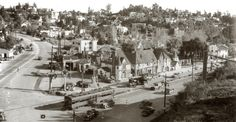 French Village at Cahenga and Highland cornerThis little nestle of buildings was known as the French Village. It was set on a triangular plot of land at the point where Highland Avenue and Cahuenga Boulevard converged as they entered the Cahuenga Pass. This puts it roughly across the street from the front entrance of the Hollywood Bowl. It opened in 1920, and throughout the 1920s, 30s, and 40s, the French Village was home to a revolving community of actors, writers, costume designers, dance…