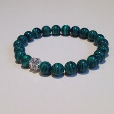 Green Malachite Beaded stretch bracelet with a silver by UniqBeadz, $22.00