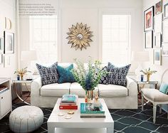 Shades of blue throughout brighten up this otherwise white room.