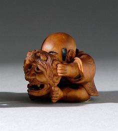 "WOOD NETSUKE 19th Century By Minko. Depicting a karako with an oni mask. Some ebony details. Signed. Height 1.3"" (3.2 cm)."