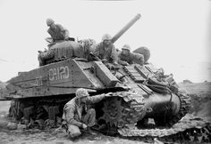 "1945 M4A3 became the preferred tank for Marine Corps. On Iwo Jima 4th and 5th Tank Battalions were equipped with M4A3 while 3rd Tank Battalion had mid-production M4A2s. Both 4th and 5th Tank Battalion used the wooden side armor but most tank photos taken on Iwo were of Bob Neiman's Company C 4th. 41 ""Cairo"" illustrate the distinctive steel bar cages over the hatches track blocks welded to the turret sides and slope plate and wooden side armor made up of narrow planks with a layer of…"