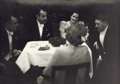 Adolf next to him Eva Braun(?)